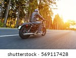 back view of motorcycle driver... | Shutterstock . vector #569117428