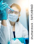 lab technician experiments with ... | Shutterstock . vector #569148460