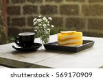 hot coffee and orange cake on a ...   Shutterstock . vector #569170909