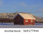 wooden shed in winter on senja... | Shutterstock . vector #569177944