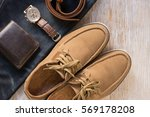 Small photo of Close up vintage leather shoes man accessory. Men's casual outfits with accessories on rustic wood background.