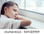 one sad little boy sitting near ... | Shutterstock . vector #569185909