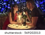 candlelight dining couple in... | Shutterstock . vector #569202013