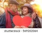 heart holding senior couple in...   Shutterstock . vector #569202064