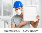 worker holding air filter for... | Shutterstock . vector #569210209
