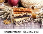 muesli and dried fruit bars... | Shutterstock . vector #569252143