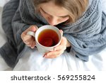 young ill woman with cup of hot ... | Shutterstock . vector #569255824