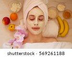 Spa Woman Applying Facial Clay...