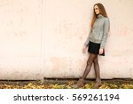 fashion girl with long hair... | Shutterstock . vector #569261194