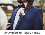 groom's boutonniere in blue.... | Shutterstock . vector #569274589
