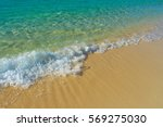 wave on the sand beach | Shutterstock . vector #569275030