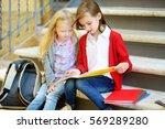 adorable little schoolgirls... | Shutterstock . vector #569289280