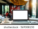 front view of cup and laptop on ... | Shutterstock . vector #569308150