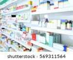 various products on shelves at... | Shutterstock . vector #569311564