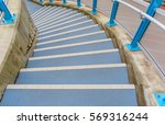 outdoor spiral cement stairs... | Shutterstock . vector #569316244