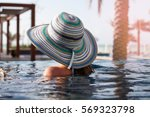 Woman In Straw Hat Enjoying Da...