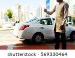 parking valet in beoge suit... | Shutterstock . vector #569330464