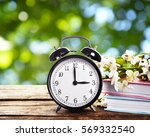 alarm clock with books and... | Shutterstock . vector #569332540