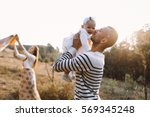 young family with little...   Shutterstock . vector #569345248
