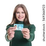 woman with driving license on... | Shutterstock . vector #569366923