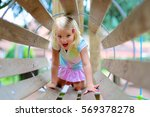 little girl playing at... | Shutterstock . vector #569378278