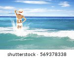 woman in swimsuit and blue sea... | Shutterstock . vector #569378338