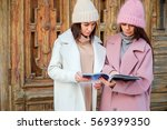 two frietwo friends reading a... | Shutterstock . vector #569399350
