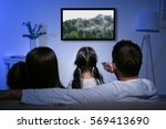 family watching television at... | Shutterstock . vector #569413690