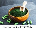superfood spirulina powder and... | Shutterstock . vector #569420284