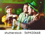 Small photo of Group of Friends Celebrating at Irish Pub
