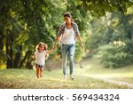 mother and daughter playing and ... | Shutterstock . vector #569434324