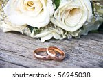 Gold Wedding Rings On A Bouquet ...