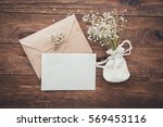 empty greeting card and flowers ... | Shutterstock . vector #569453116