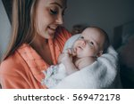 young family at home caring for ... | Shutterstock . vector #569472178