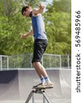young skater boy grind square... | Shutterstock . vector #569485966
