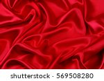 closeup of ripples in red silk... | Shutterstock . vector #569508280
