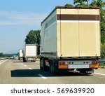 trucks on the roadway in... | Shutterstock . vector #569639920
