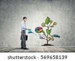 handsome businessman presenting ... | Shutterstock . vector #569658139