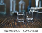 russian vodka pouring from the... | Shutterstock . vector #569664133