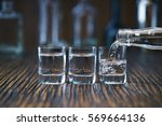russian vodka pouring from the... | Shutterstock . vector #569664136