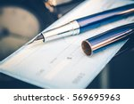 issuing payment by check by... | Shutterstock . vector #569695963