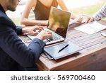 business team working on laptop ... | Shutterstock . vector #569700460
