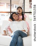 indian mother and daughter... | Shutterstock . vector #569701558