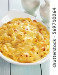 Small photo of American mac and cheese, macaroni pasta in cheesy sauce