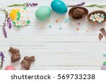easter eggs over blue wooden... | Shutterstock . vector #569733238
