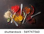 various spices spoons on stone... | Shutterstock . vector #569747560