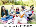 happy young friends group... | Shutterstock . vector #569751079