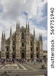 Small photo of Milan, Italy - August 18, 2015: Piazza del Duomo , a multitude of people animate the square in front of the main symbol of the city, the Duomo (Cathedral)