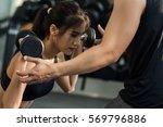 personal trainer helping weight ... | Shutterstock . vector #569796886