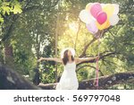 beautiful young woman holding... | Shutterstock . vector #569797048